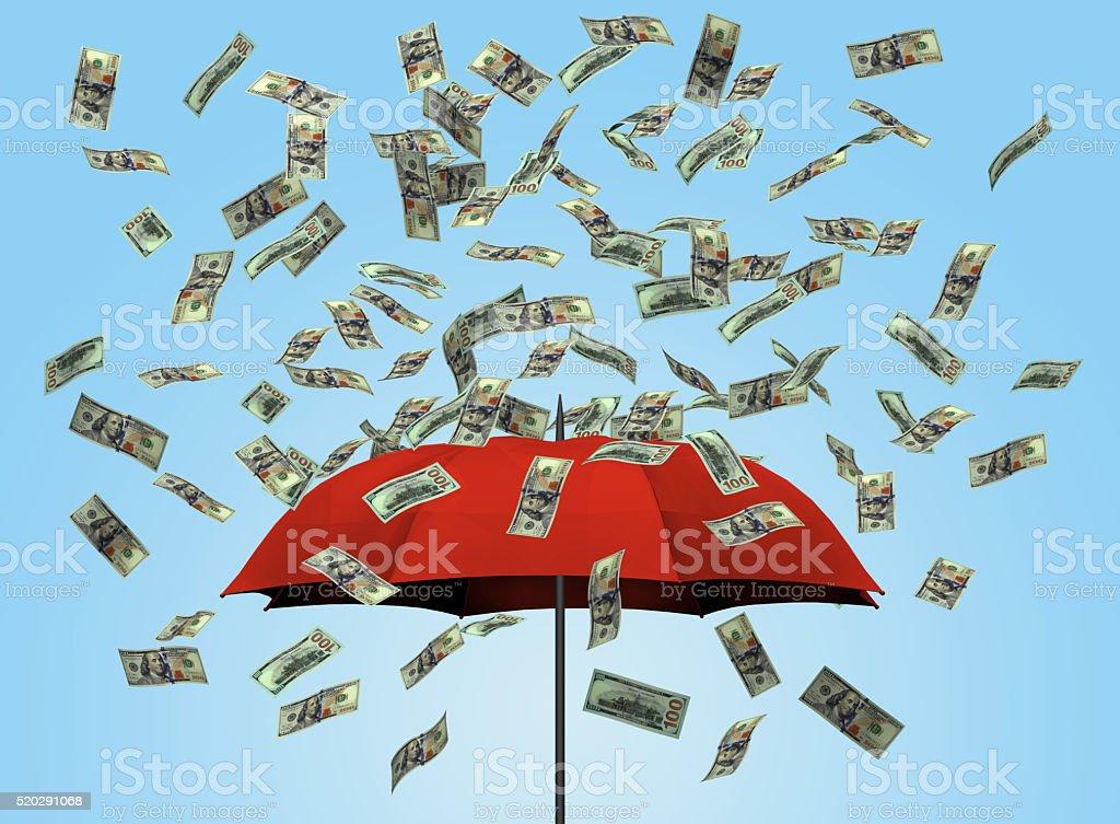 Umbrella and dollar bills stock photo