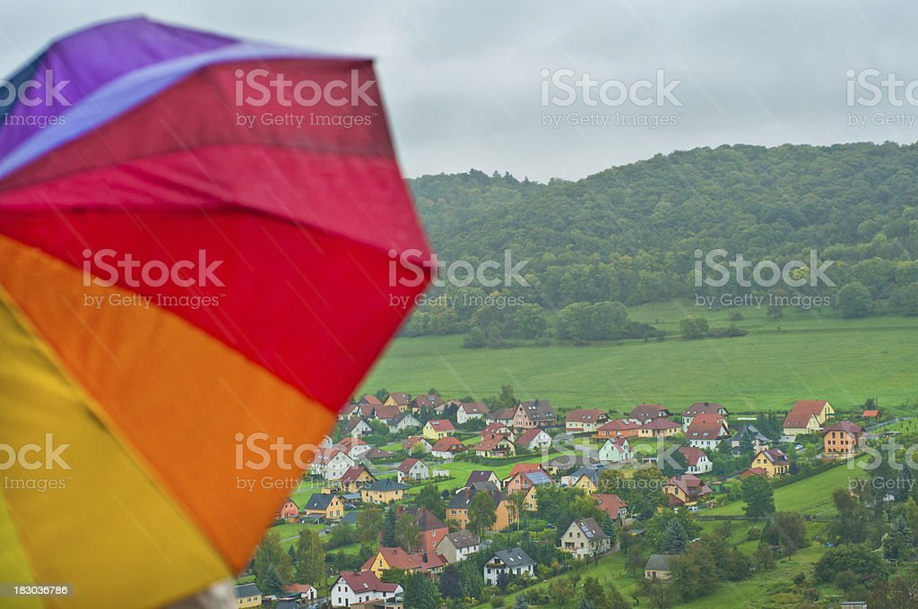 Umbrella and falling rain with view to a valley stock photo