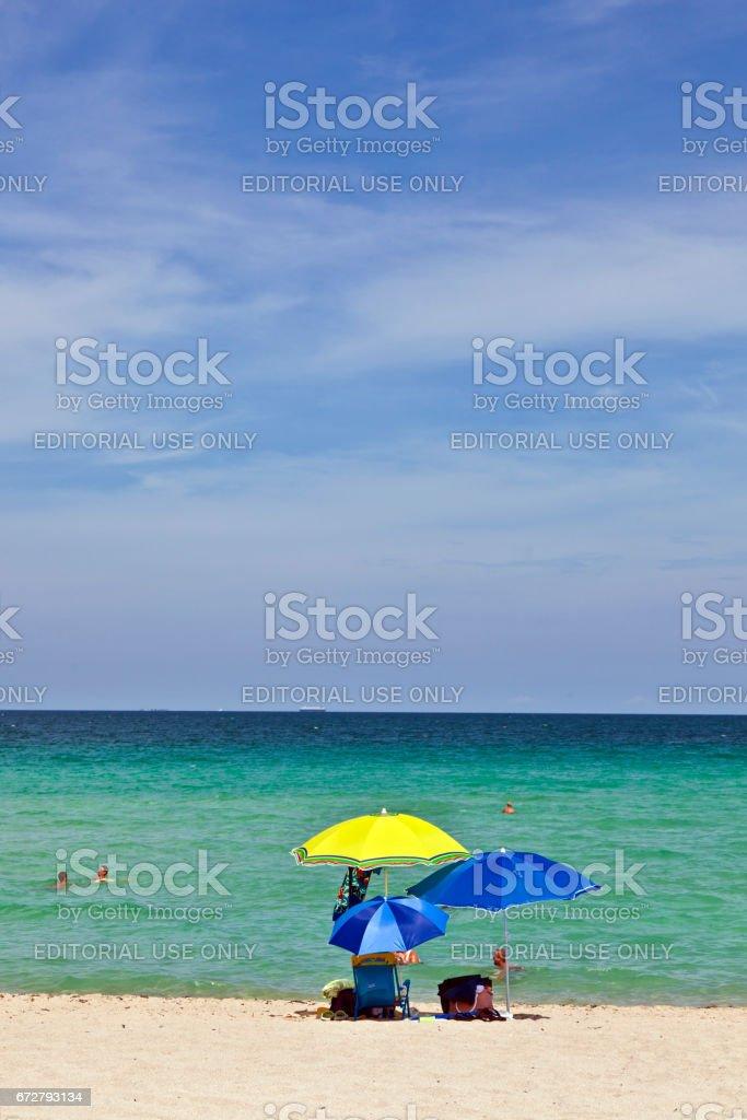 umbrella at the beautiful beach for sun protection stock photo