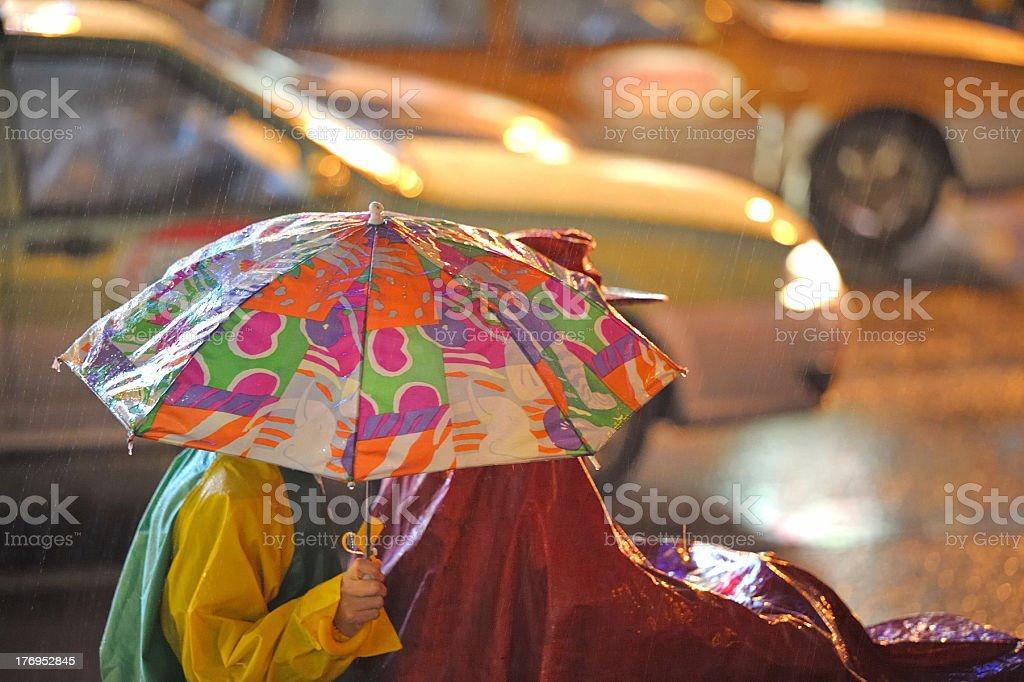 Umbrella bikers royalty-free stock photo
