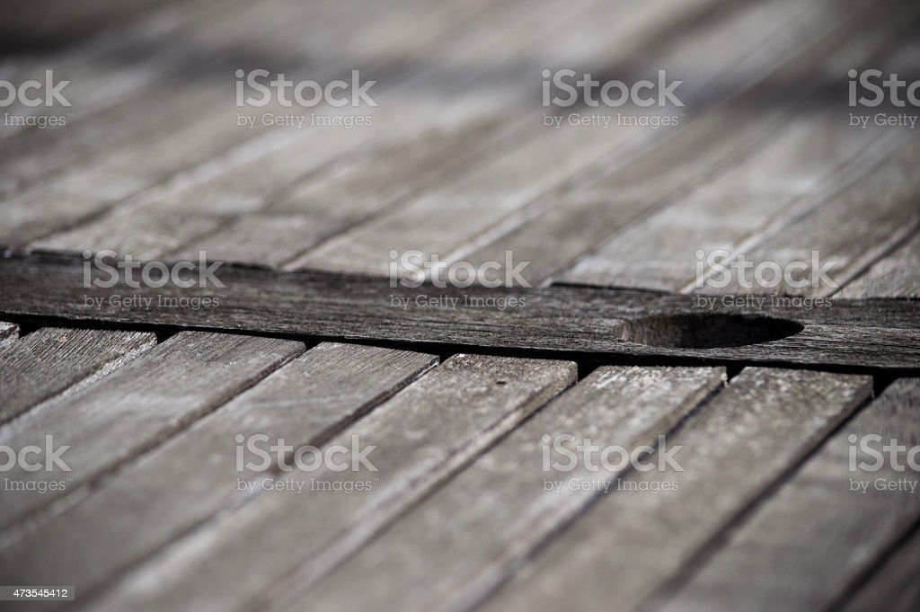 Umbrella Hole in an Old Table royalty-free stock photo