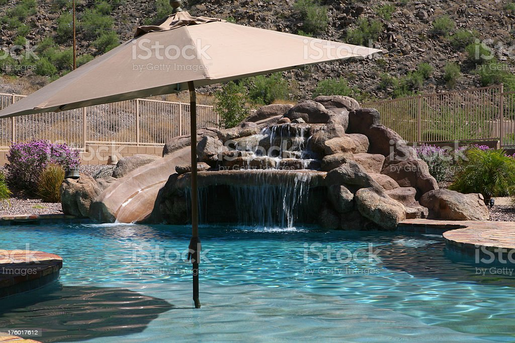 Umbrella in front of rock pool royalty-free stock photo