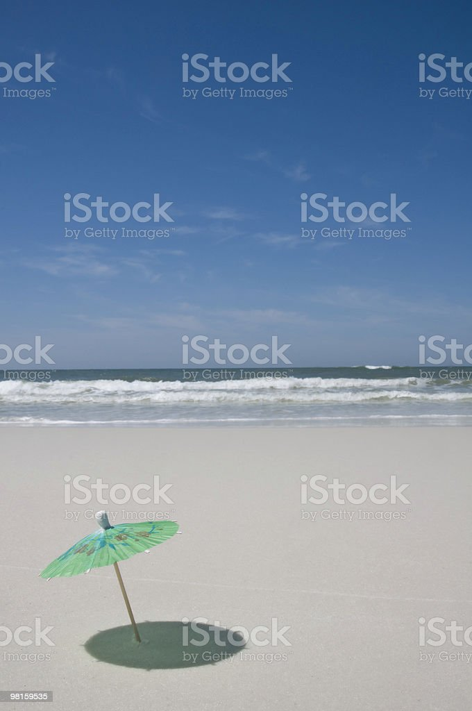 Umbrella on the beach with surf in backgroud royalty-free stock photo