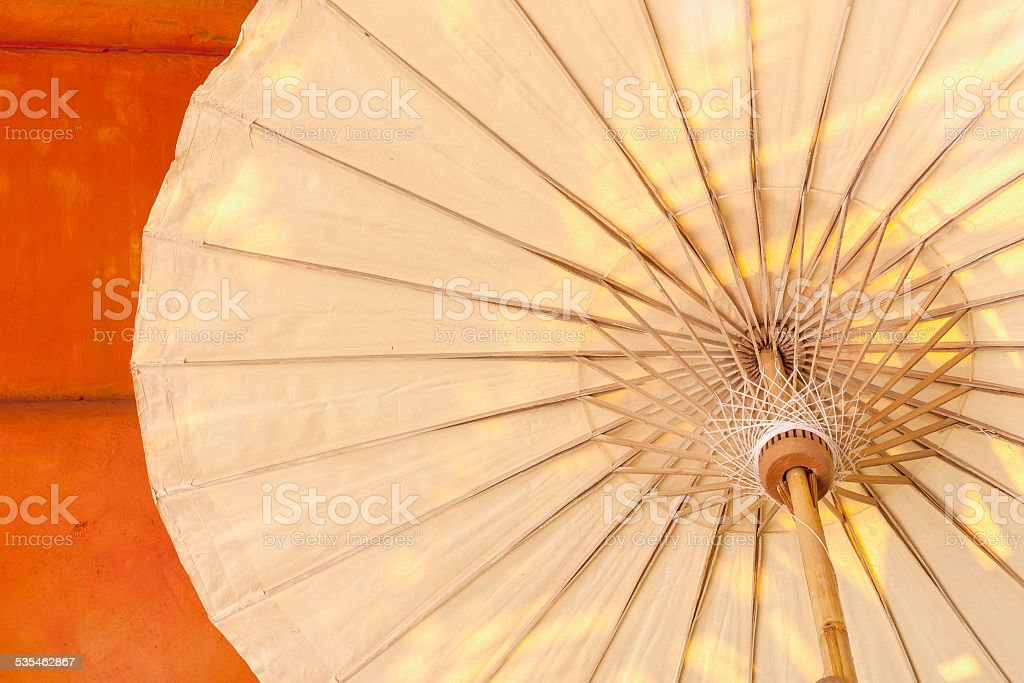 Umbrella structure with the orange wall royalty-free stock photo