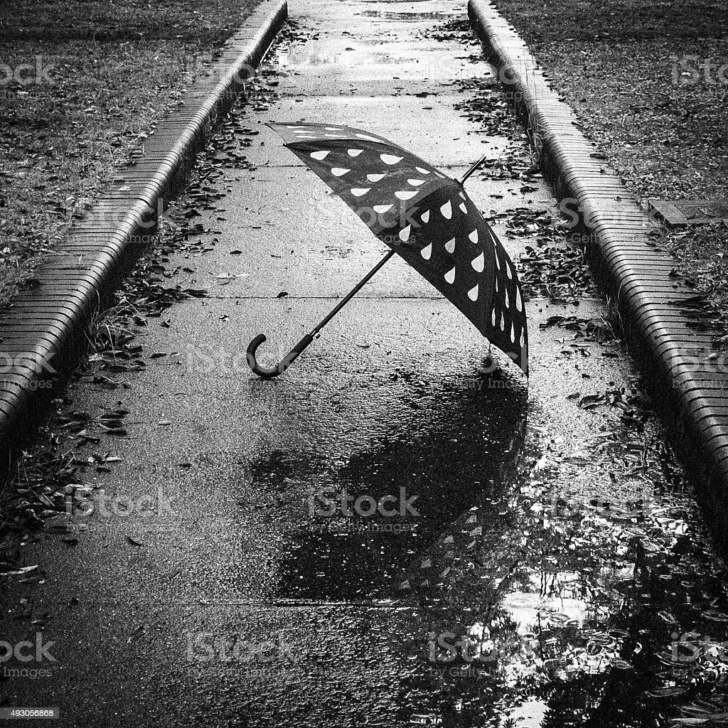 Umbrella that has been placed in solitary stock photo