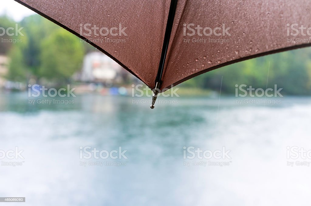 Umbrella with raindrops, detail. Color photo stock photo