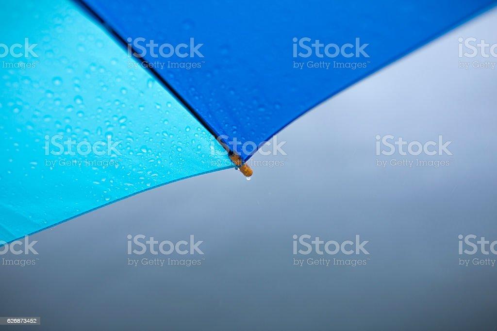 Umbrella with raindrops, stock photo