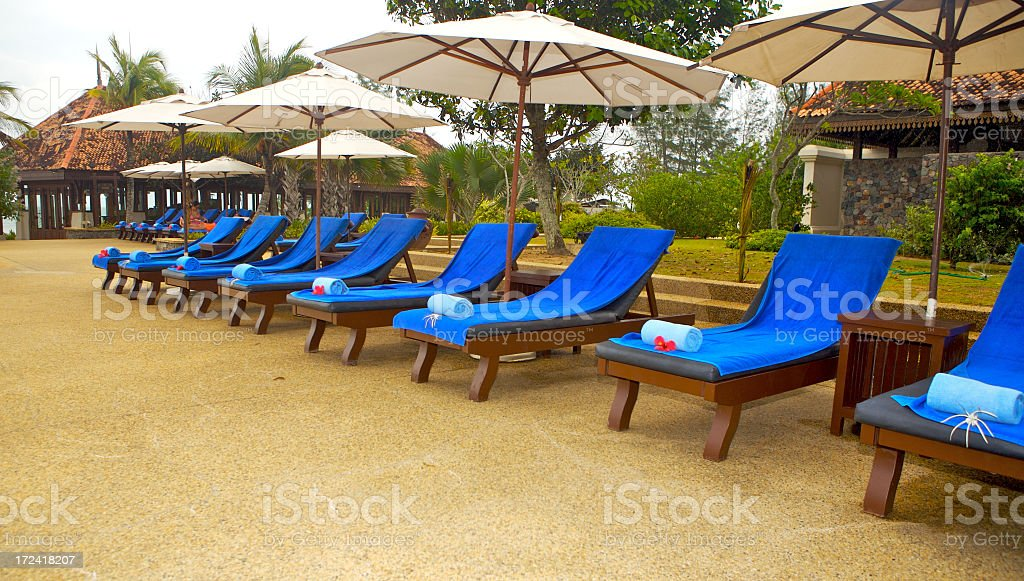 Umbrellas and Chairs at the Pool stock photo