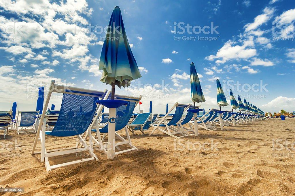 Umbrellas and chairs in Versilia, Italy stock photo