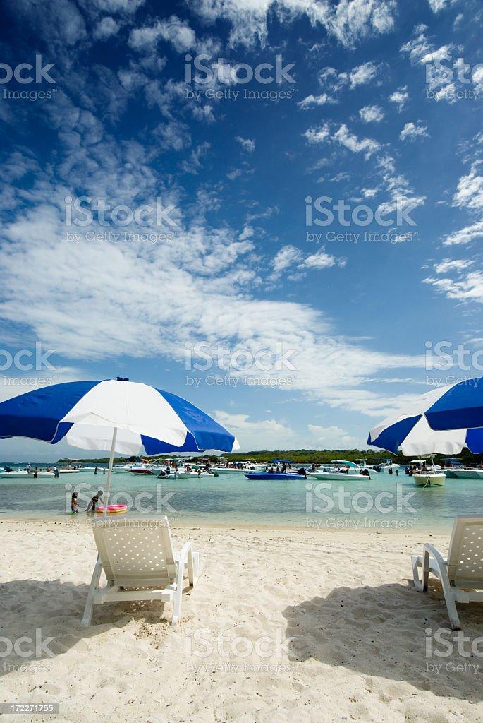 Umbrellas at a Tropical island  white sand beac royalty-free stock photo