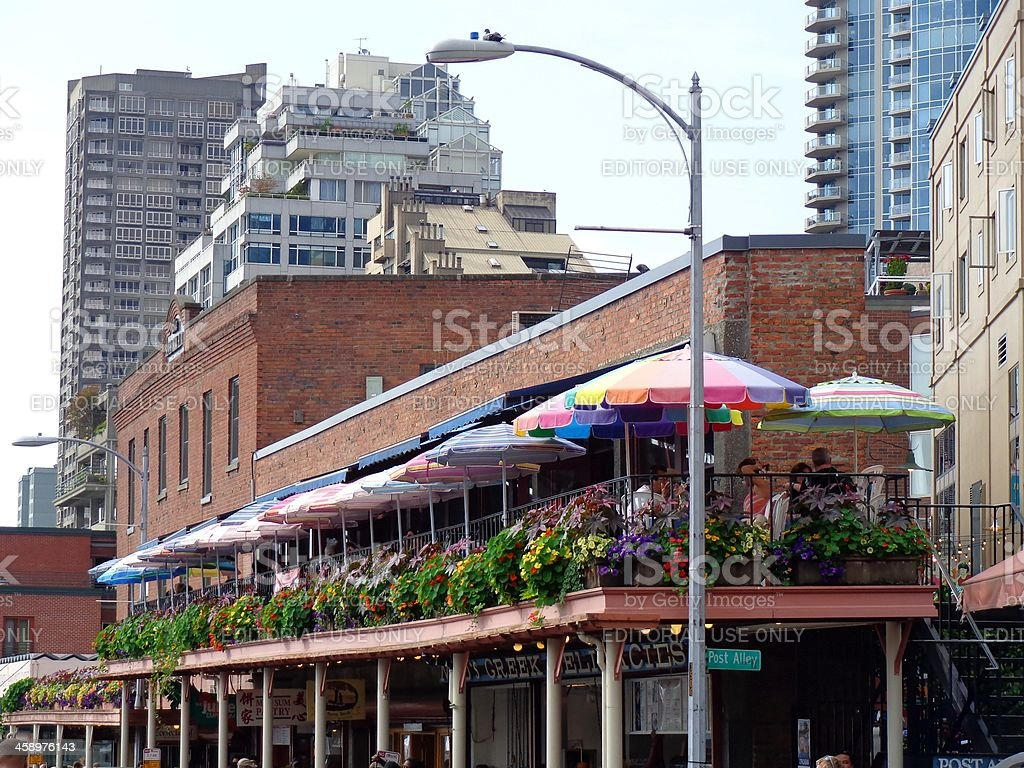 Umbrellas Cover People Dining at Pikes Place Market Seattle Washington stock photo