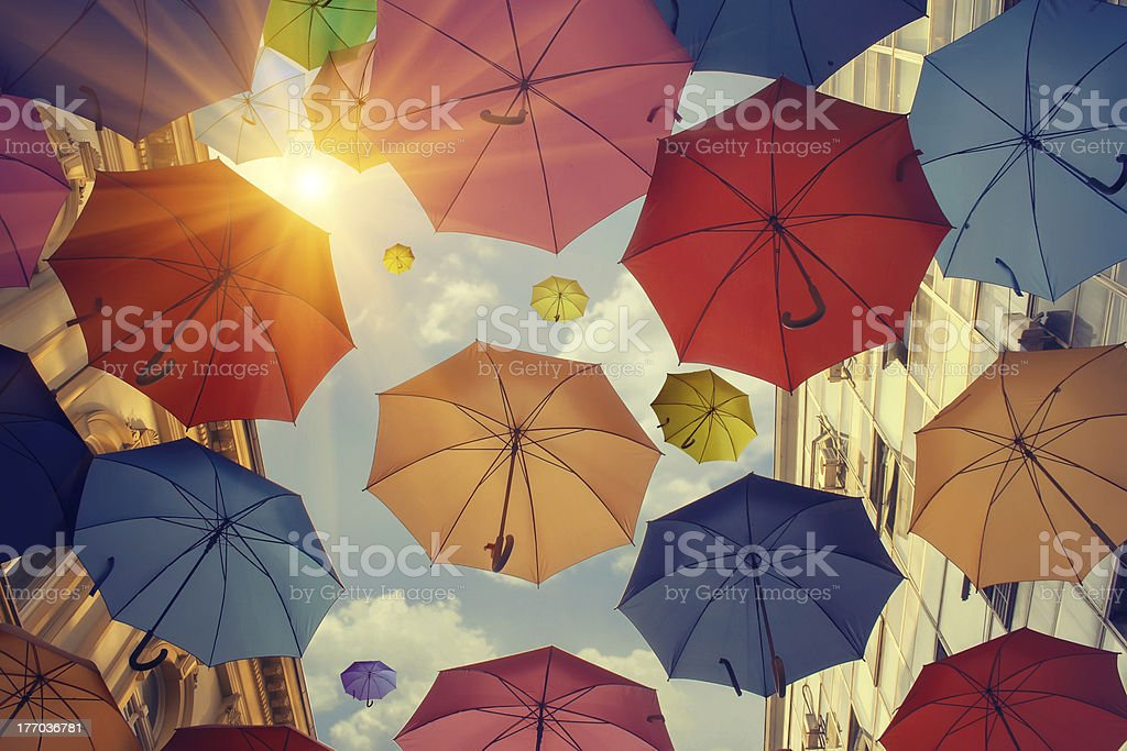 Umbrellas falling from the sky stock photo
