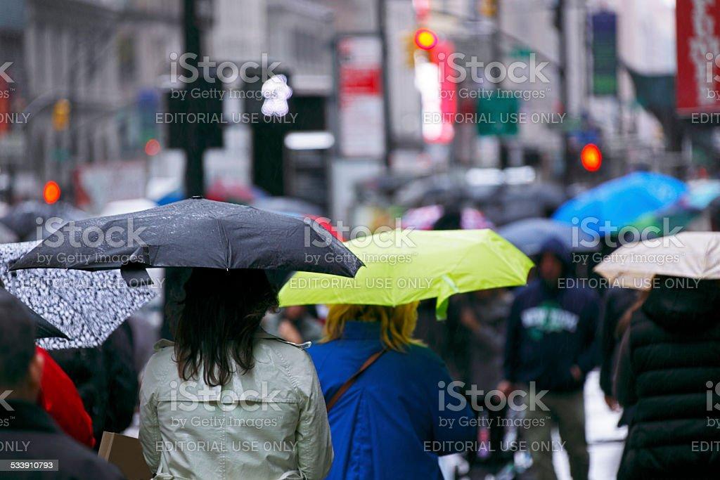 Umbrellas in wet, wintry New York City stock photo