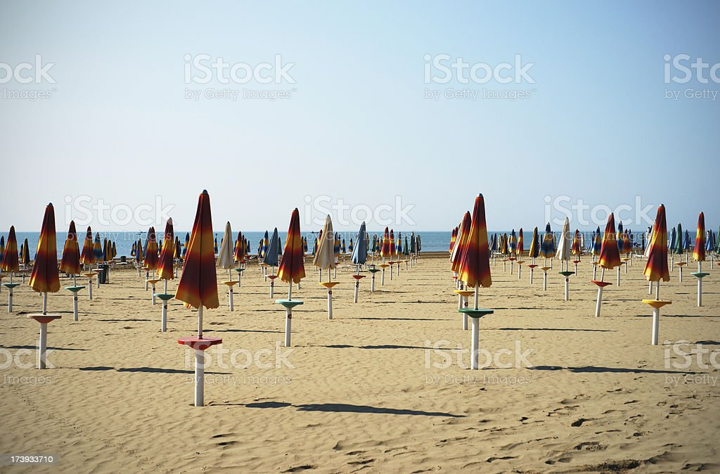 Umbrellas on sandy beach royalty-free stock photo