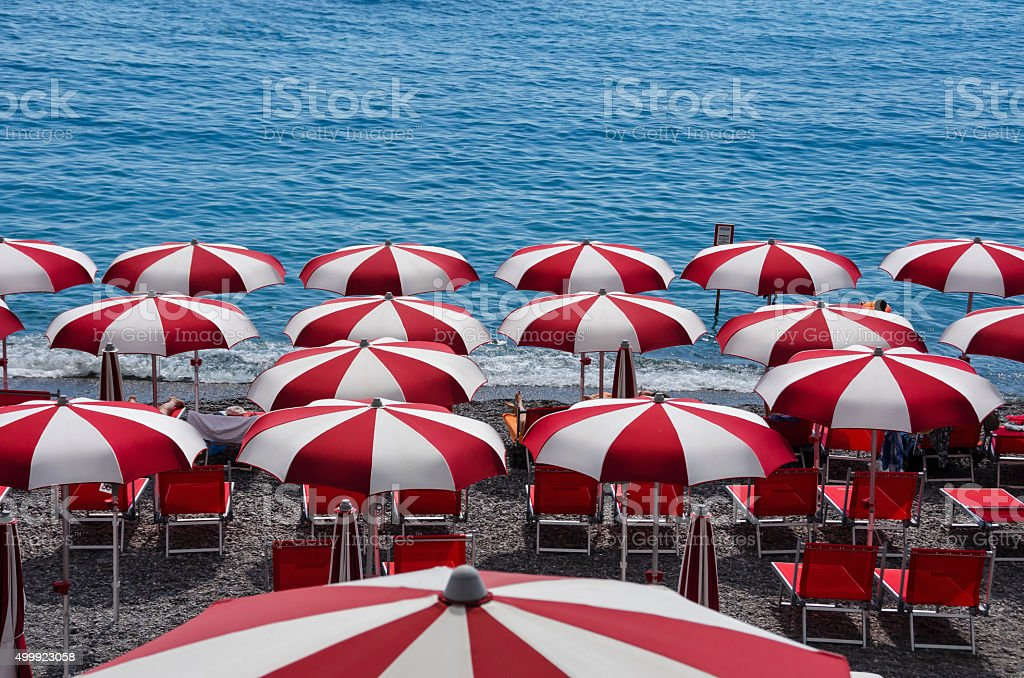 Umbrellas on the Beach in Amalfi, Italy stock photo