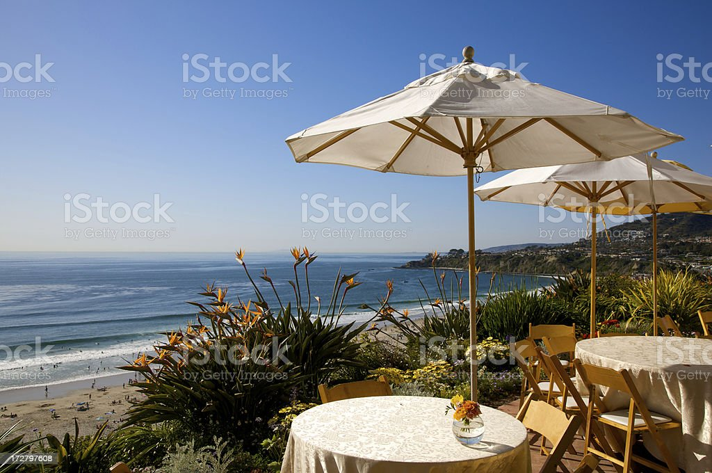 umbrellas on the hill above pacific ocean royalty-free stock photo