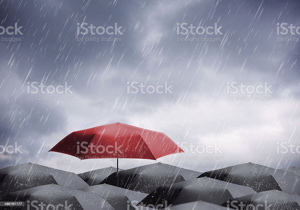 Umbrellas under rain and thunderstorm stock photo