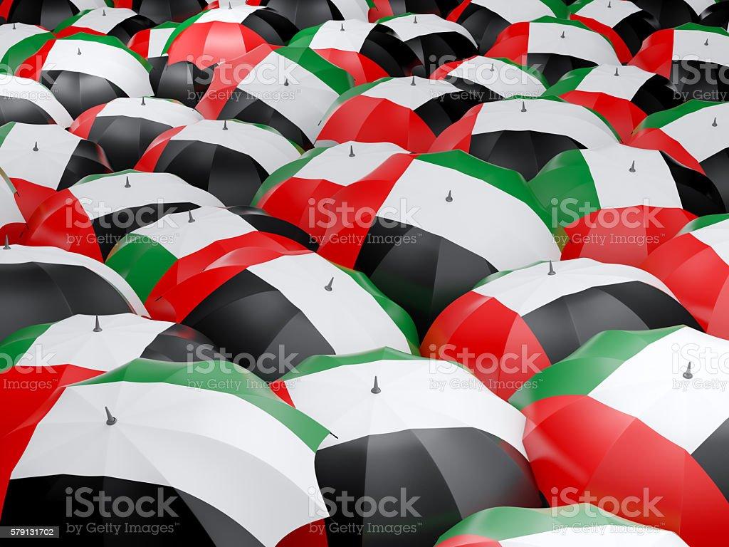 Umbrellas with flag of united arab emirates stock photo