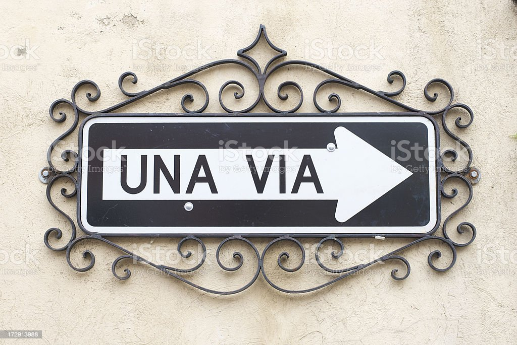 Una Via One Way Sign in Spanish with Decorative Border royalty-free stock photo