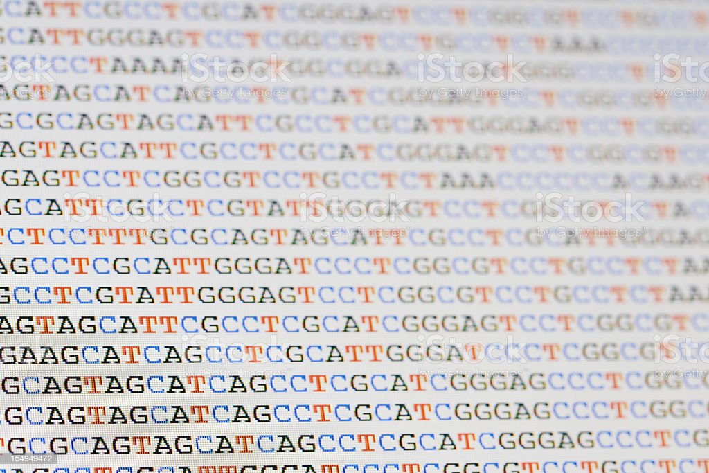 Unaligned DNA sequences letters on LCD screen stock photo