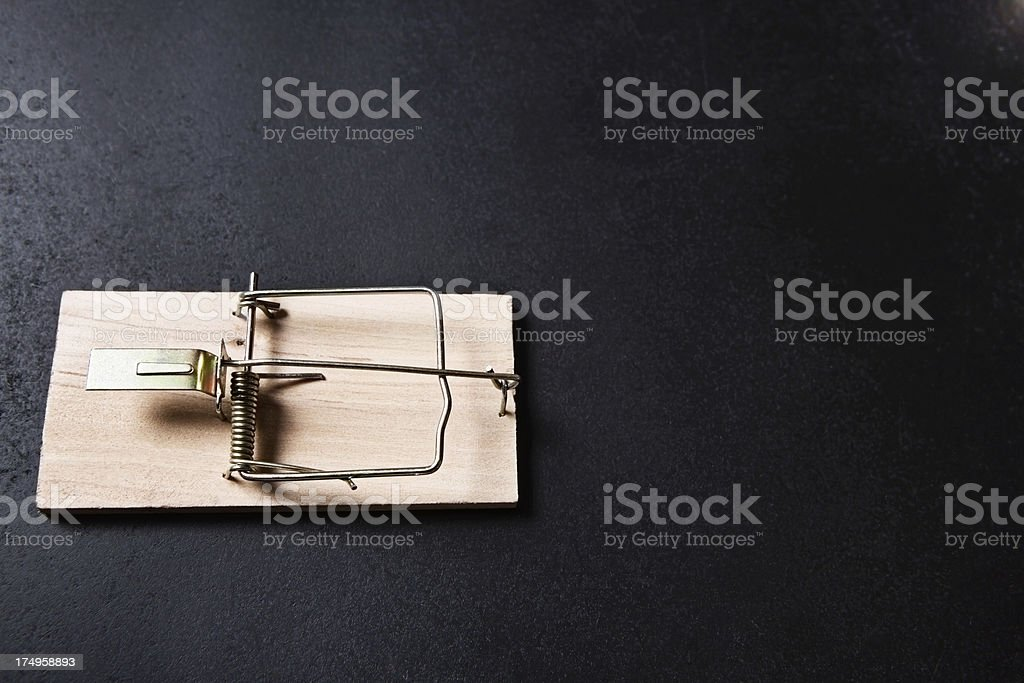 Unbaited wood-and-wire mousetrap on black background stock photo
