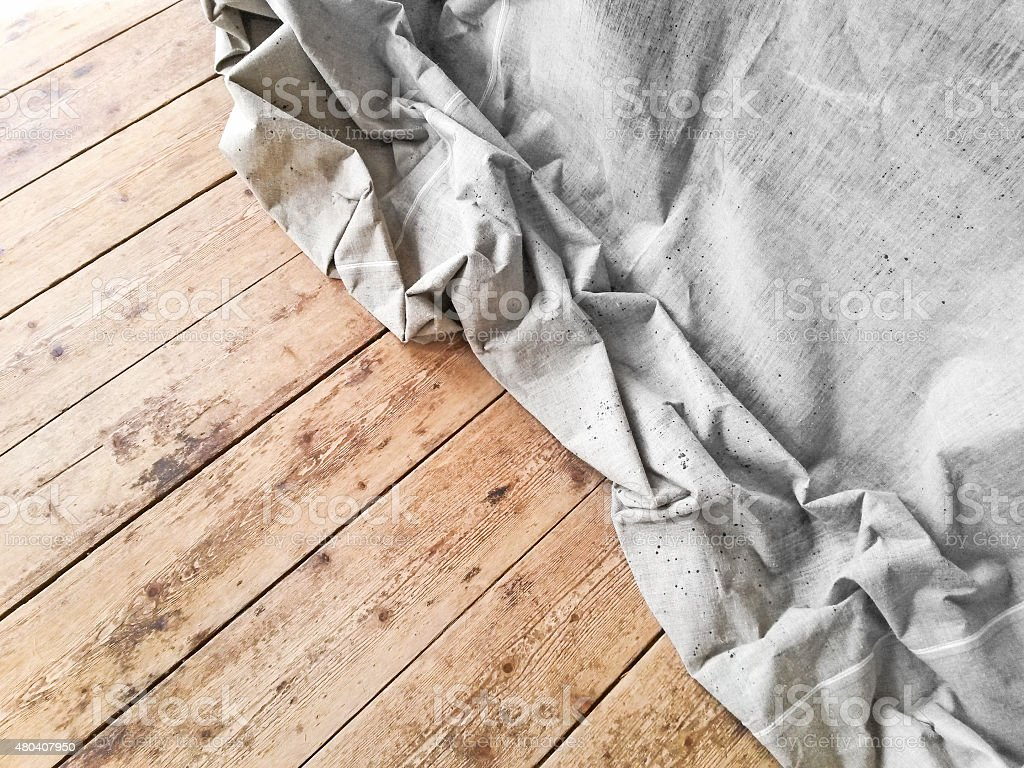 Unbleached textile on ructic floor stock photo