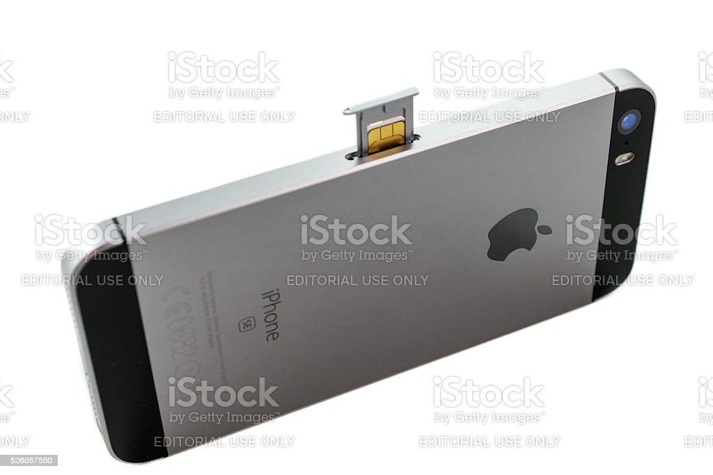 Unboxing and first run of the new iPhone SE stock photo