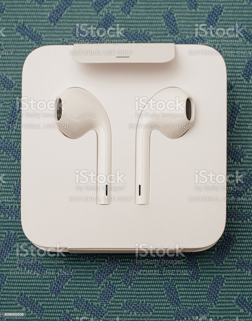 unboxing New Apple Earpods Airpods on textile background stock photo