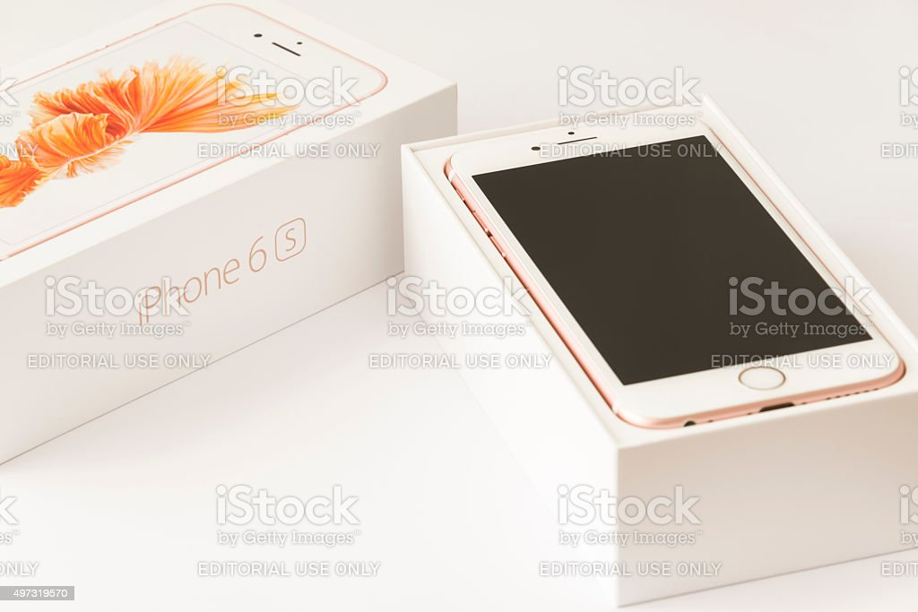 Unboxing Rose gold Apple iPhone 6s stock photo