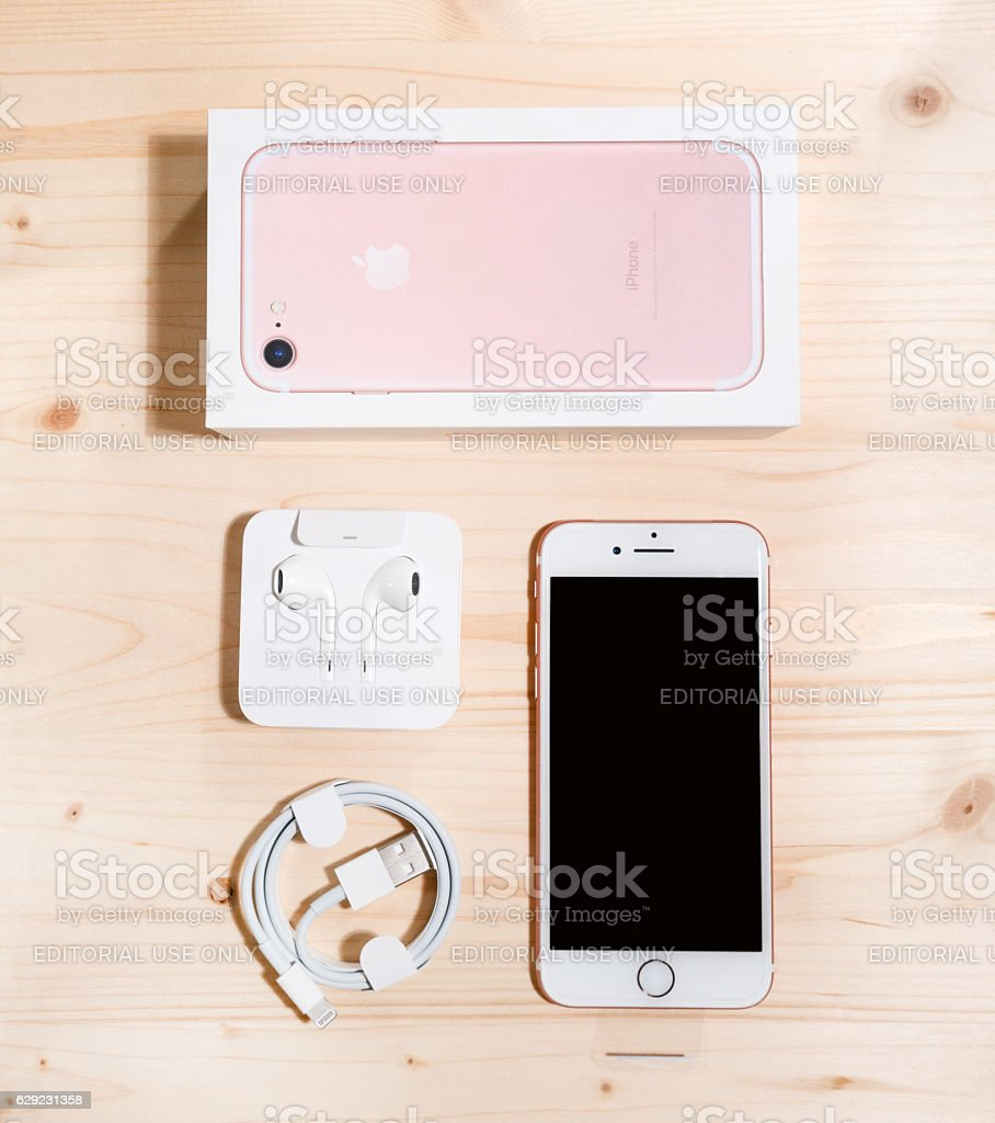 Unboxing Rose gold Apple iPhone 7 stock photo