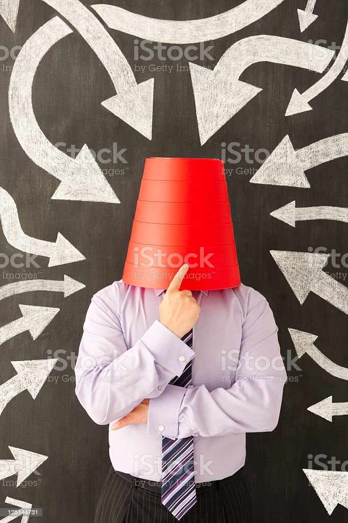 Uncertain businessman stock photo