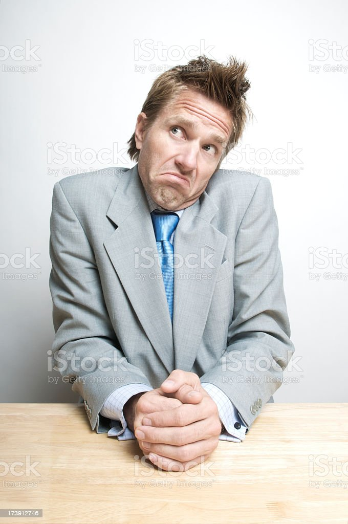 Uncertain Businessman Shrugging with a Heck If I Know Expression royalty-free stock photo