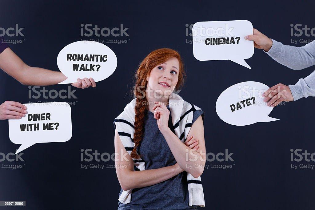 Uncertain girl and speech balloons stock photo
