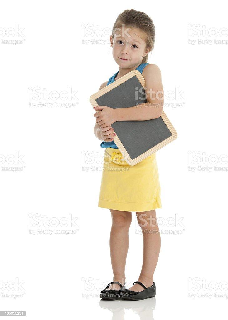 Uncertain Kindergarten Girl with Small Chalkboard stock photo
