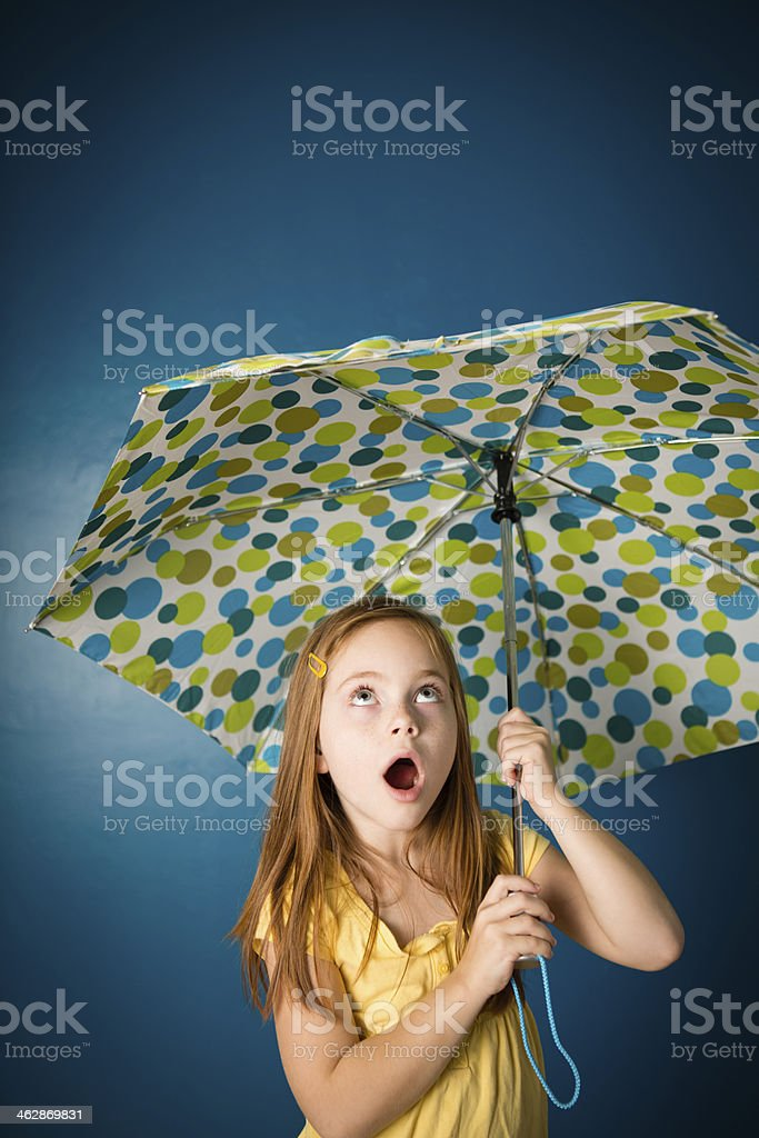 Uncertain Seven Year Old Red-Haired Girl Holding Umbrella royalty-free stock photo