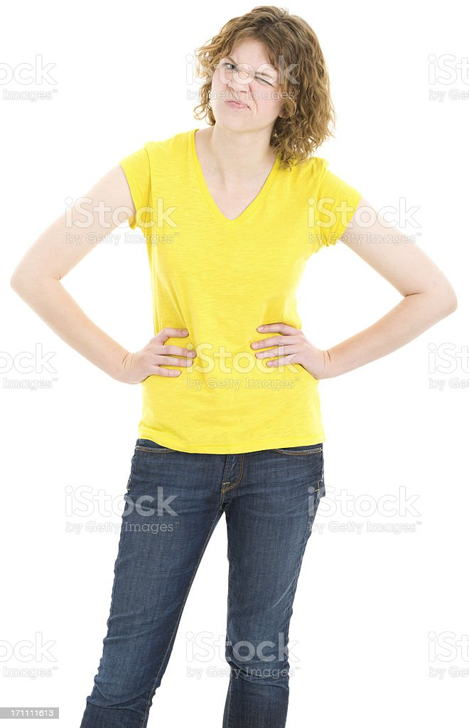 Uncertain Young Woman Standing With Hands On Hips royalty-free stock photo