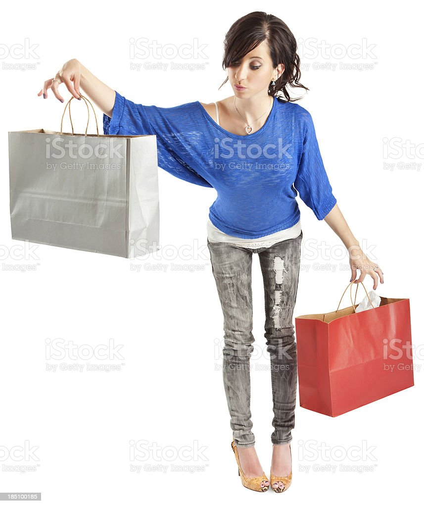 Uncertain Young Woman with Paper Shopping Bags royalty-free stock photo