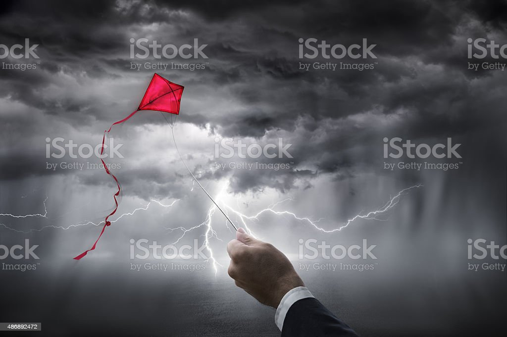 uncertainty aspirations business - kite in storm stock photo