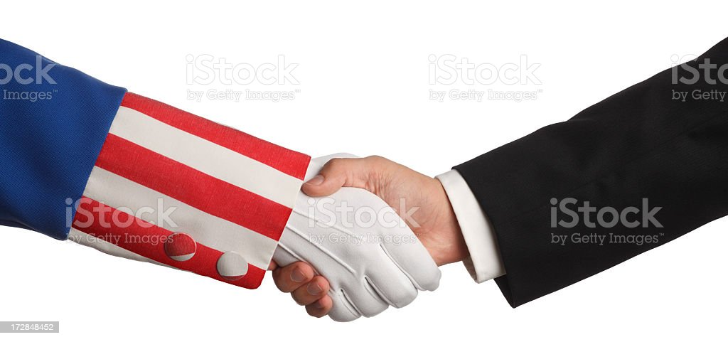 Uncle Sam and a businessman shaking hands on white background stock photo