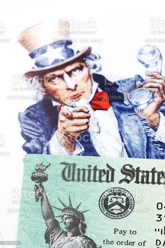 Uncle Sam and IRS check stock photo