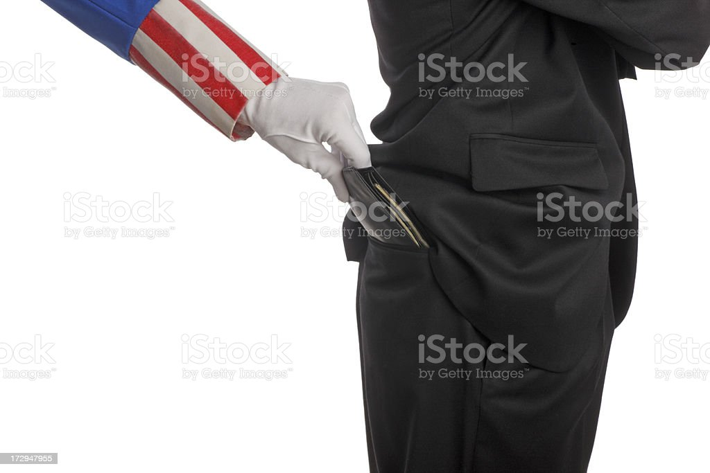 Uncle Sam pick pocketing a man in a business suit. stock photo