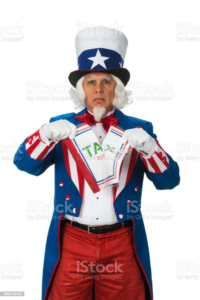 Uncle Sam tearing up the US Tax Code document stock photo