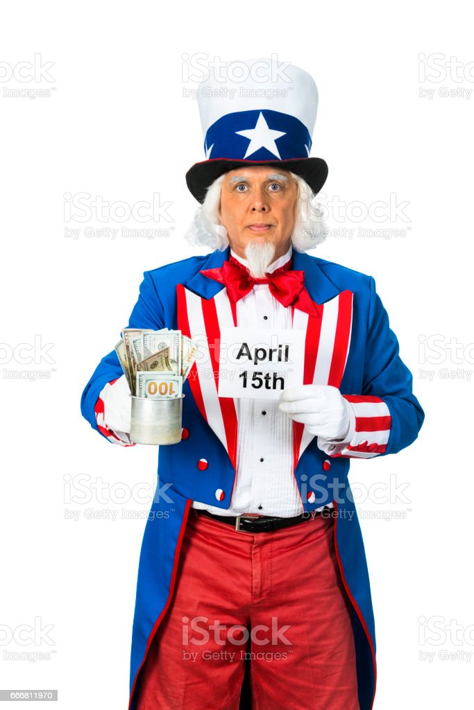 Uncle Sam tin cup of money and sign while standing against a white background stock photo