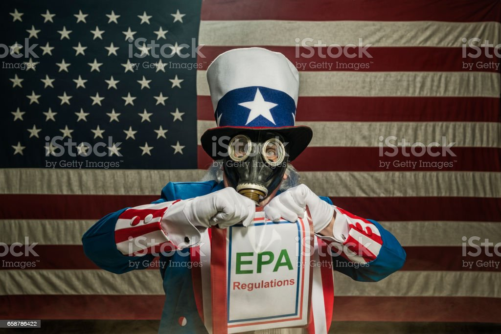 A patriotic Uncle Sam character wearing a full face gas mask while...