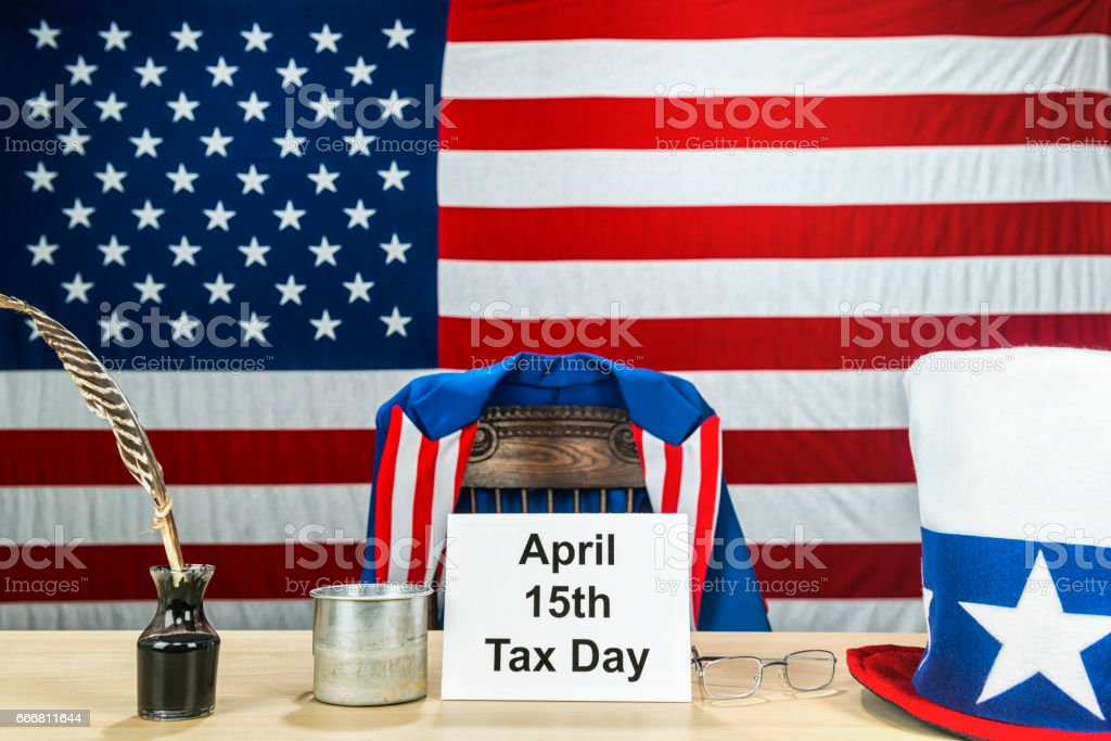 Uncle Sam's desk ready to collect taxes on April 15th, tax day in the US stock photo