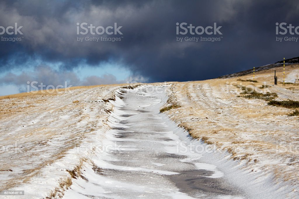 Uncleaned icy road stock photo