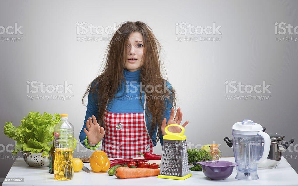 Uncombed depressive woman in the kitchen stock photo