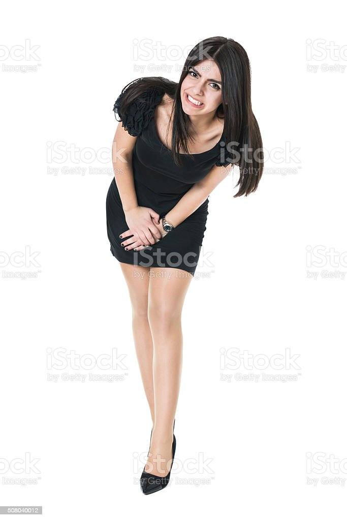 Uncomfortable Young Woman Needs to use the Restroom stock photo
