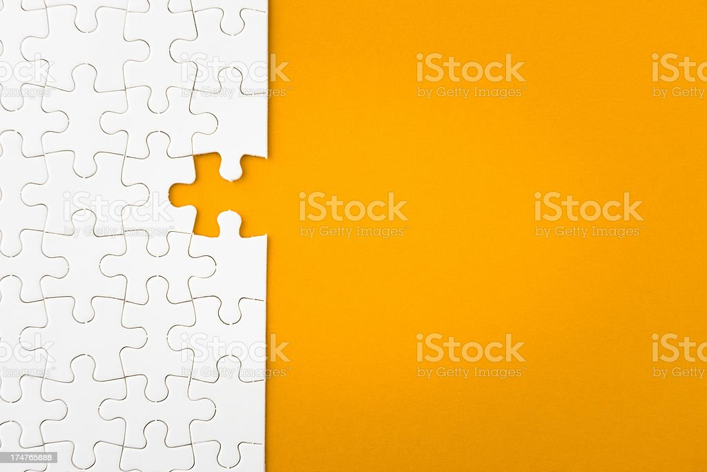 Uncompleted puzzle stock photo