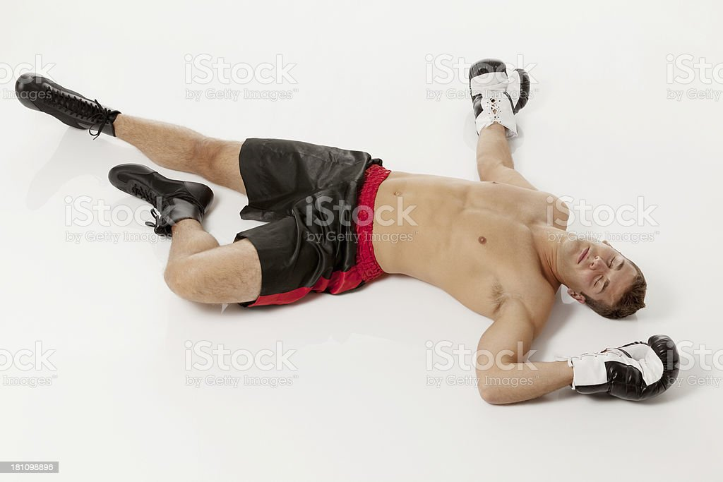 Unconscious boxer lying on the floor royalty-free stock photo
